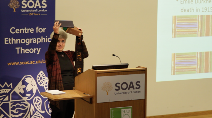 """Jane Guyer comparing the original publication with the first English translation at """"The gift that keeps on giving"""" workshop (SOAS, 30 April 2016)"""