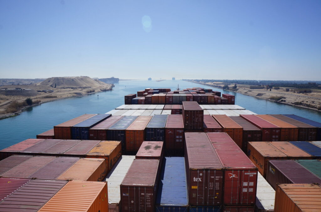 Image of containers on a ship passing through the Suez Canal.